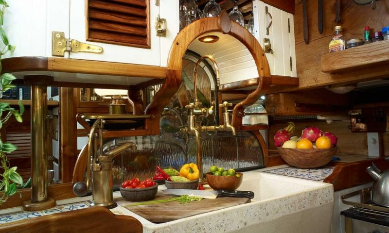 A tasteful blend of historical period elements and modern functionality. Antiques and stained glass blend in an elegant design as seen in this picture from the galley.