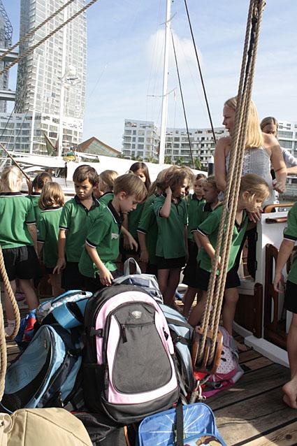 Childern visiting the Historic vessel Vega load Kits 4 Kids bags