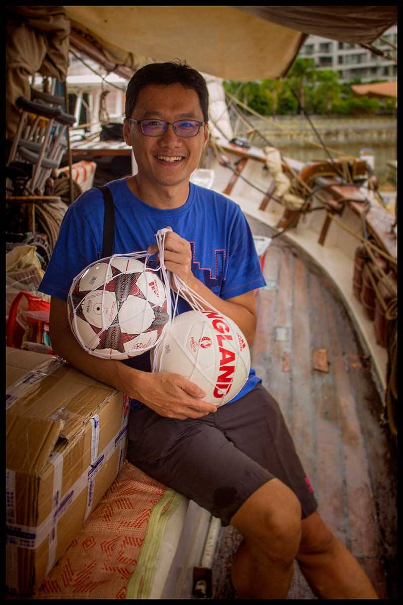 Two new footballs will make some small school very happy for sure thanks to our friend Kwek Loong Chin.
