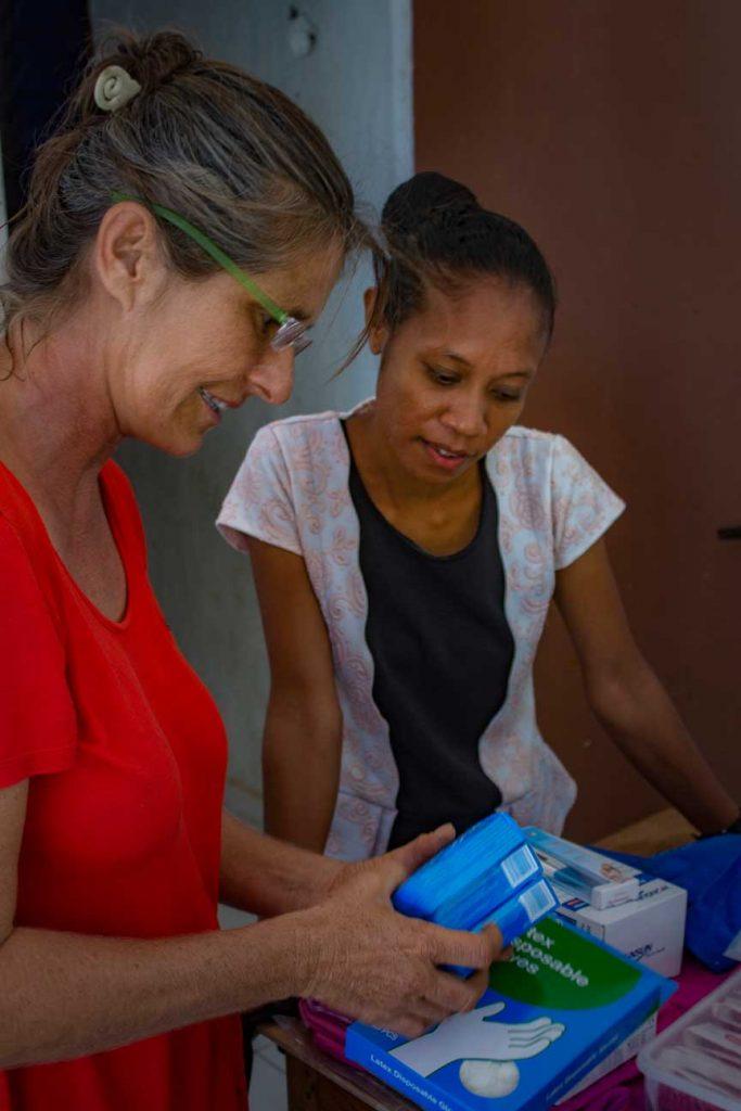 Indira Afonso midwife in Macadade and Vega crew member Meggi Macoun unpack supplies.