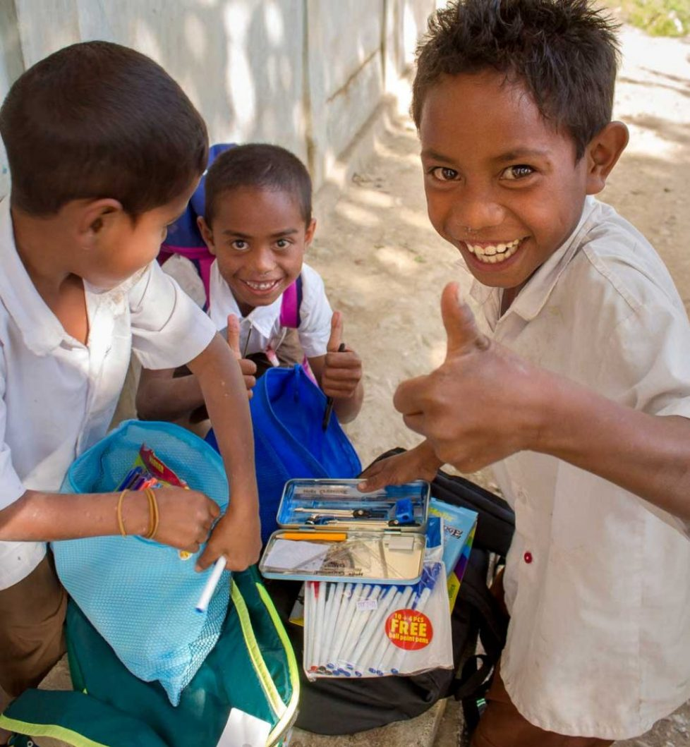 Students with their new schoolbags, East Timor.