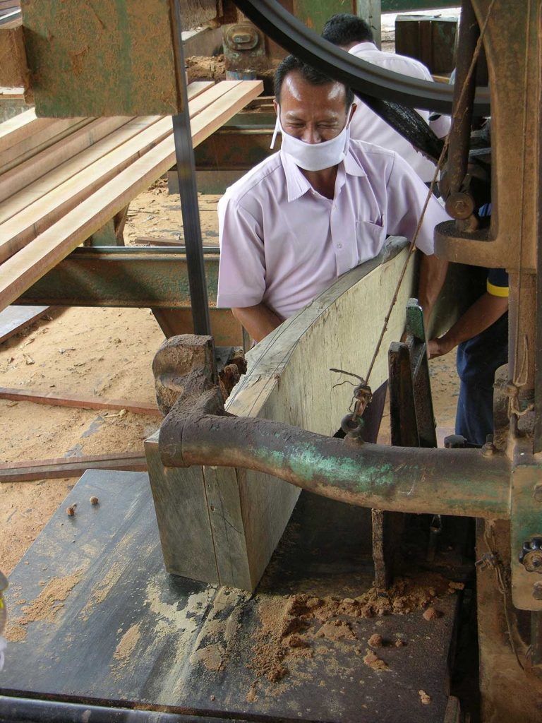 Cutting large pieces of re-cycled 100 year old teak on a large band saw is an art in itself.