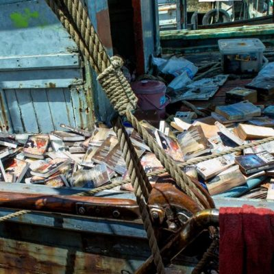 PSS shipyard left all our books out to rot on old fishing boat.